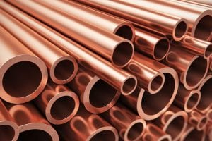 New copper pipes are seen in a stack.